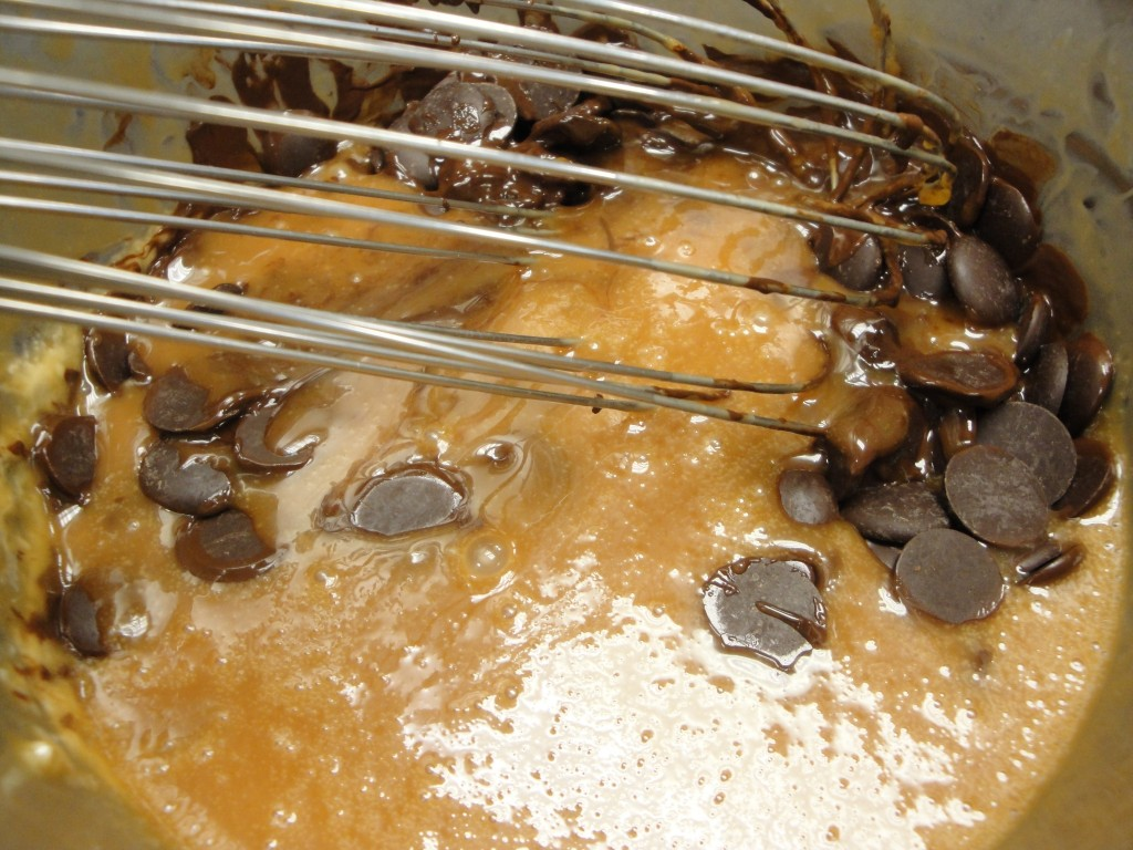adding chocolate to caramel mixture