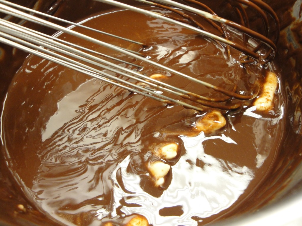 adding butter to chocolate mousse mixture